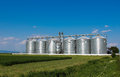 Silos in green field Royalty Free Stock Photo