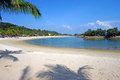 Siloso beach a white sand at sentosa island singapore it s a famous touristic destination with lush palms protected sea and Stock Photography