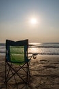 Silouette beach chairs at sunsetp sunset vacation sunset concep Royalty Free Stock Photos