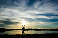 Silouette man at sunset relax Royalty Free Stock Photography