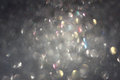 Silver background of defocused abstract lights. silver bokeh lights Royalty Free Stock Photo