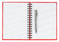 Silver ball point pen on red notebook isolated white background Stock Photography