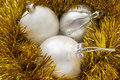 Silver balls in tinsel group of three christmas garlands of golden Stock Photo