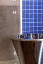 Silver basin in bathroom closeup of a modern wash Royalty Free Stock Photography