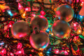 Silver Baubles on Xmas Lights Stock Photo