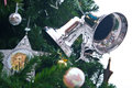 Silver bell on christmas tree Stock Image
