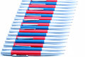 Silver blue and silver red metal pens on white background many isolated Royalty Free Stock Photos