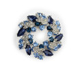 Silver brooch with blue and white gemstones Royalty Free Stock Photo