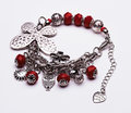 Silver butterfly bracelet with red gems Royalty Free Stock Photo