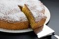 Silver cake slice taking away slice cake chocolate coconut over black background Stock Image