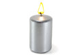 Silver candle burning on a white background Royalty Free Stock Photography