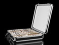 Silver case with money on black background Royalty Free Stock Photo