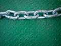 Silver chain on Green Steel Floor Plate Stock Images