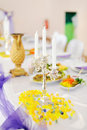 Silver chandelier on decorated wedding table Royalty Free Stock Photos