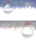 Silver christmas background with glass ball defocused bright bokeh Royalty Free Stock Images