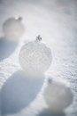 Silver christmas balls on snow real outdoors winter holidays concept shallow depth of fields Royalty Free Stock Images