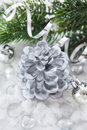 Silver christmas decoration cone candle balls and branch of c fir tree Stock Photos