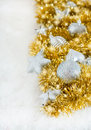 Silver Christmas decorations and golden tinsel Stock Photos