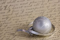 Silver Christmas ornament on calligraphy background Royalty Free Stock Photo