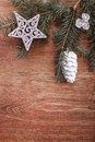 Silver Christmas ornaments and fir tree branch on a rustic wooden background Royalty Free Stock Photo