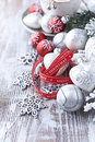 Silver christmas ornaments and gift ribbon on painted wood Royalty Free Stock Photos