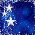 Silver Christmas stars on blue background Royalty Free Stock Photo