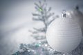 Silver christmas tree decorations on snow real outdoors winter holidays concept shallow depth of fields Stock Photography