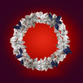 Silver christmas wreath with decorations isolated on red background