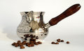 Silver coffee pot and beans with shadows Stock Images