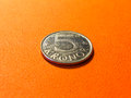 Silver coin five swedish crowns on orange Royalty Free Stock Photo