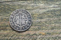 Silver coin old spanish on wood Royalty Free Stock Photography