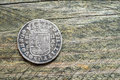 Silver coin old spanish on wood Royalty Free Stock Photo