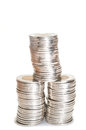 Silver coins stack on white background Stock Photos