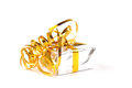 A silver colored gift box with a yellow ribbon on white background Stock Photography
