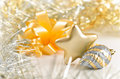 Silver cone and golden star xmas still life Royalty Free Stock Photos