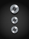 Silver control buttons on black chome dials a texture background Royalty Free Stock Photo