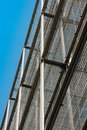 Silver corrugated metal wall seen from below with clear blue sky Royalty Free Stock Photo