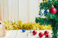 Silver crismas ball on tree on wooden background Royalty Free Stock Photo