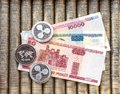 Silver crypto coins Ripple XRP, paper denominations Belarusian ruble. Metal coins are laid out in a flat background, close-up view