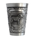 Silver cup with a picture of an aries zodiac pewter bas relief isolated on white background Royalty Free Stock Image