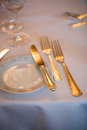 Silver cutlery set on a table Stock Image