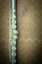 Silver flute with old steel background Royalty Free Stock Photo