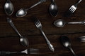 Silver forks and spoons on wooden background Royalty Free Stock Photo