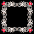 Silver frame delicate with ruby hearts on a white background Royalty Free Stock Images