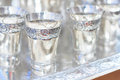 Silver goblets a plate with Royalty Free Stock Images