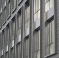 Silver gray windows of modern building architectonic detail Royalty Free Stock Photo
