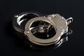 The silver handcuffs Royalty Free Stock Photo