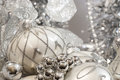 Silver ivory christmas ornaments and colored with stars and small bokeh in background Stock Photography