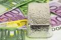 Silver kg bullion of kilogramm fine on eurobanknotes Royalty Free Stock Photos