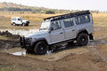 Silver land rover defender sw on x course bafokeng – may going through water obstacle at new track opening event may at bafokeng Stock Image